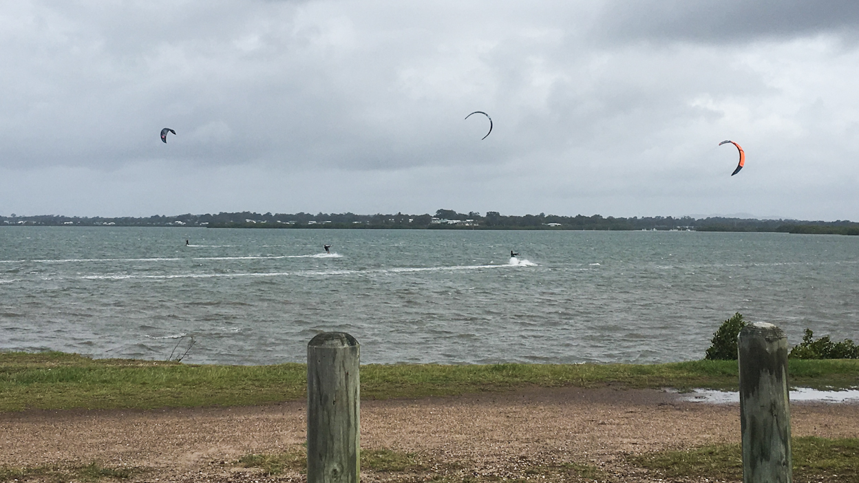 Kite Surfers making the most of their Monday at Lota Brisbane Bayside