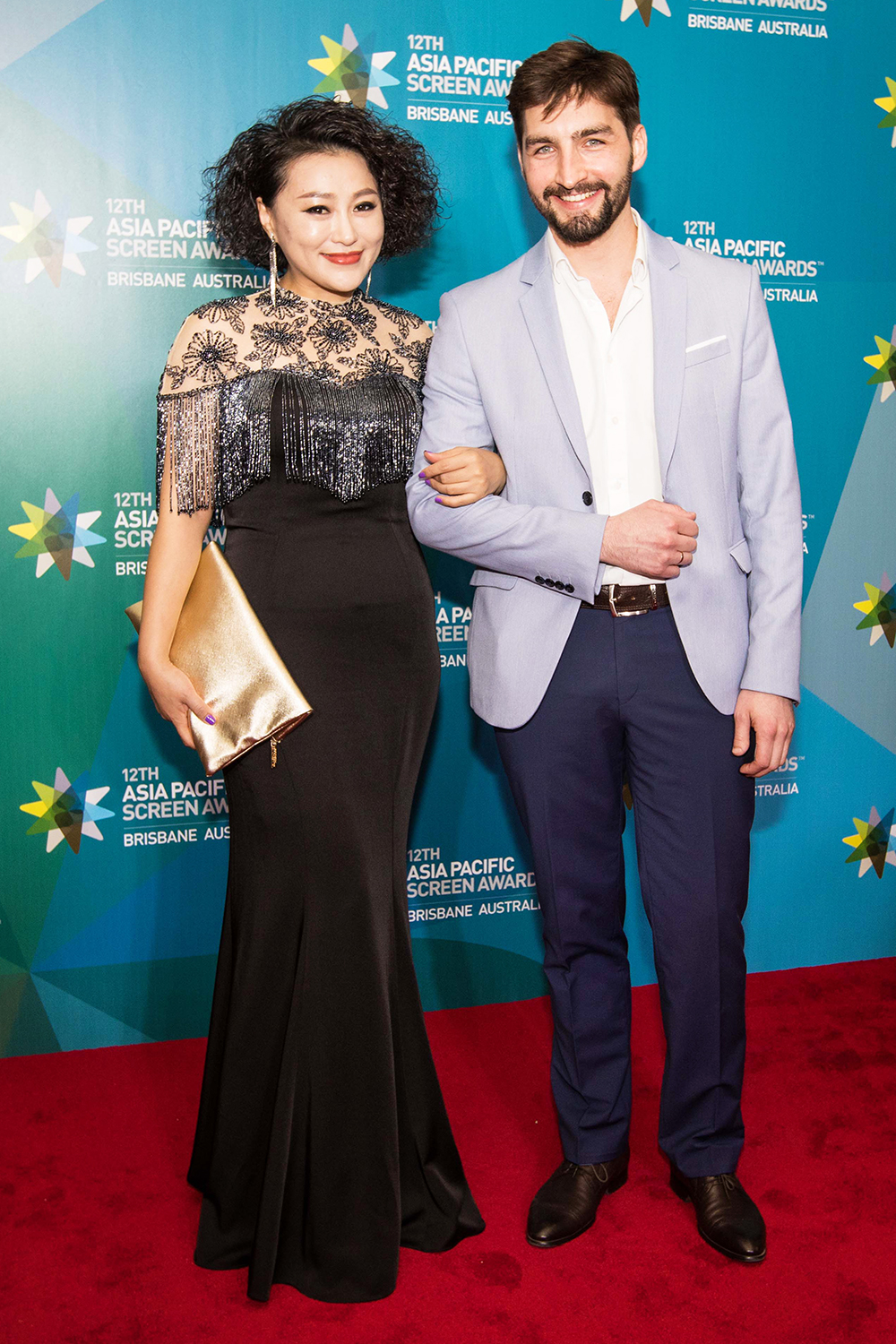 Asia Pacific Screen Awards guests walking the Red Carpet at the Brisbane Exhibition and Convention Centre