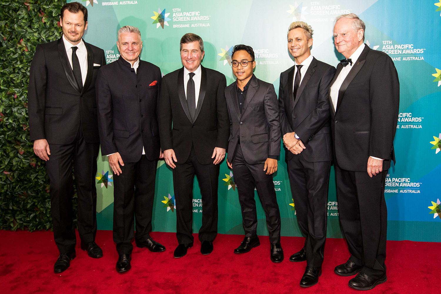 Suited up men on the Red Carpet for the Asia Pacific Screen Awards held in Brisbane